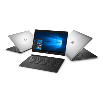 Three Dell XPS notebook computers arranged in a semi-circle. An XPS 13 (Model 9350, Dino 2 XPS) is on the far left, open 45 degrees facing back left. An XPS 12 (Model 9250) 2-in-1 (Veneno), is in the middle, with the tablet screen hovering above a keyboard attachment and the XPS 15 (Model 9550, Berlinetta XPS) is on the right, open 45 degrees facing back right.